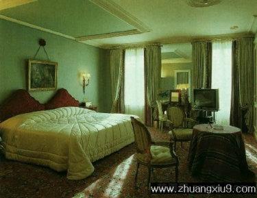家庭室内装修设计图片之卧室装修图片:卧室实景图暖色床,卧
